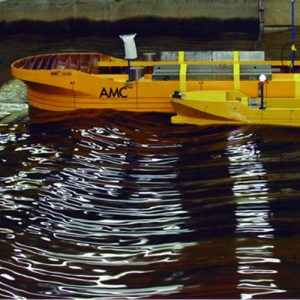 Experimental Study on the Relative Motions Between a Floating Harbour Transhipper and a Feeder Vessel in Regular Waves